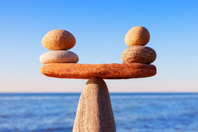 image of small stones balanced on a larger stone