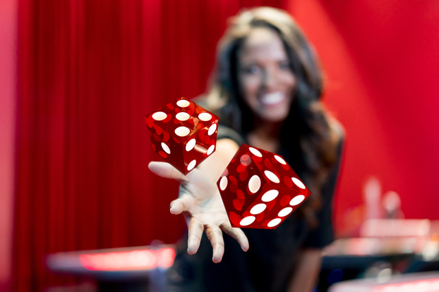 image of woman throwing dice