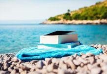 image of books at the beach